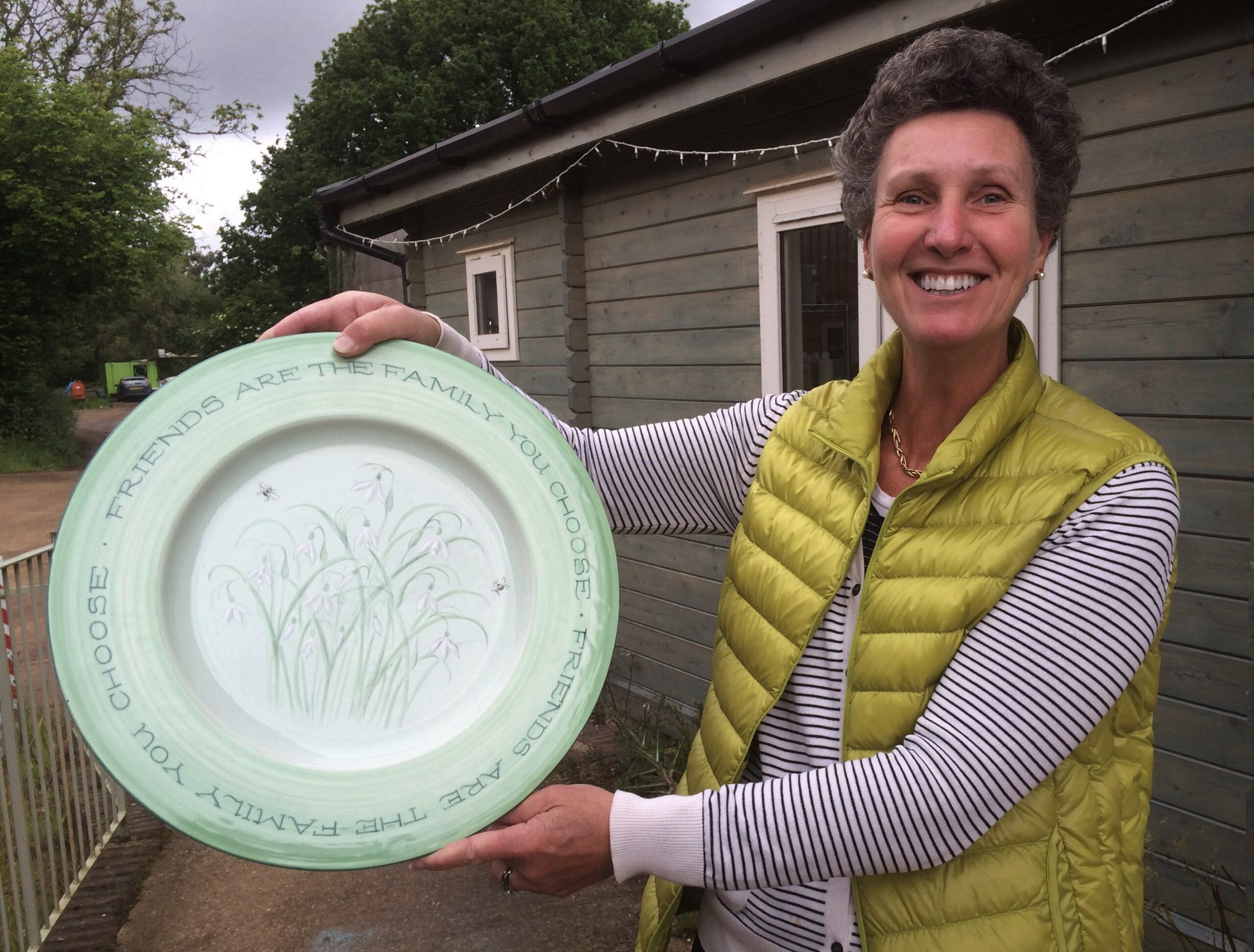 A very happy customer with a bespoke Snowdrop Plate